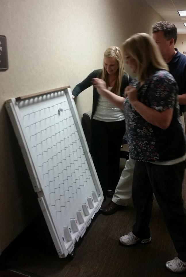 Lynn April star employee recipient playing plinko for prizes