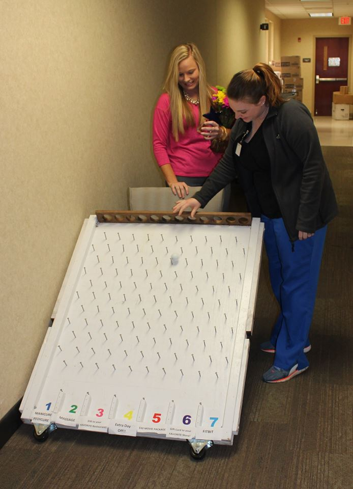 Samantha May star employee recipient playing plinko for prizes