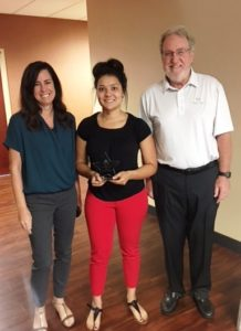 Kasside October star employee recipient posing with April and Dr. James Heinrich